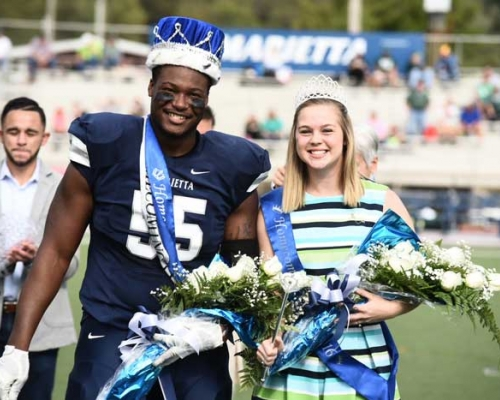 HC king and queen on football field