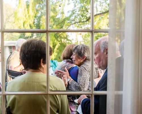 women hugging at homecoming