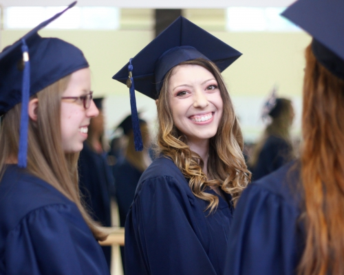 PA students smile and laugh during the graduation ceremony