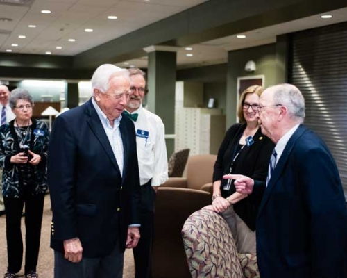David McCullough in the basement of library with guests