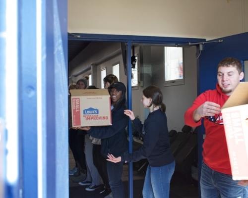 Students loading boxes on MLK Day of Service