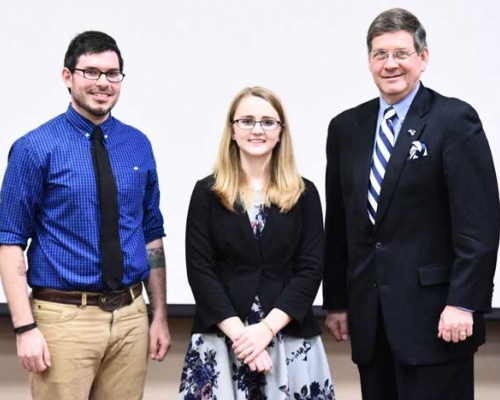 PioBiz competitors Nathan Maciag and Ashley Klopfenstein with President Bill Ruud