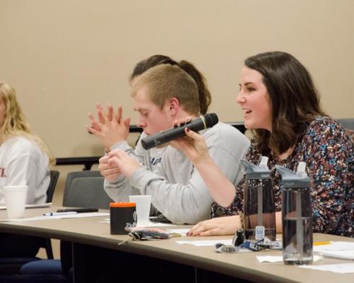Audience members speaking at PioPitch