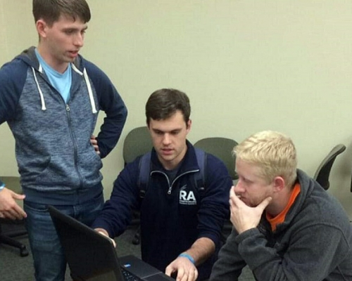 Marietta students working out a problem on a laptop computer