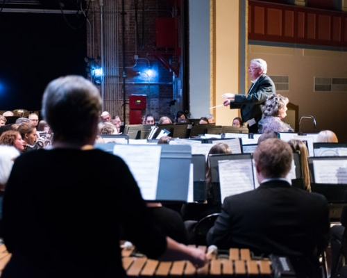 Director Marshall Kimball leading the band concert at Peoples Bank Theatre