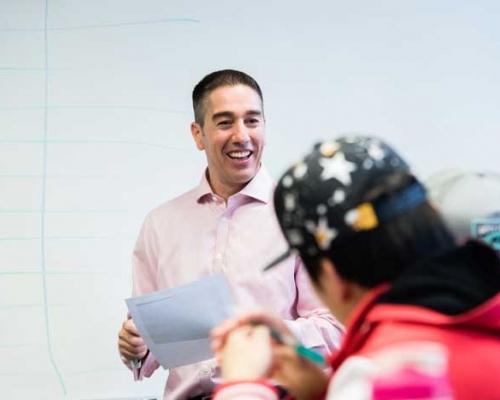 Alumnus Mark Vizza teaching a marketing class