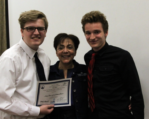 Two high school students with Jackie Khorassani at Junior PioBiz