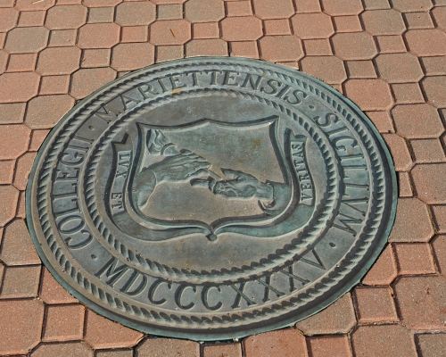 The Marietta College Seal in the brick ground outside of the Legacy Library