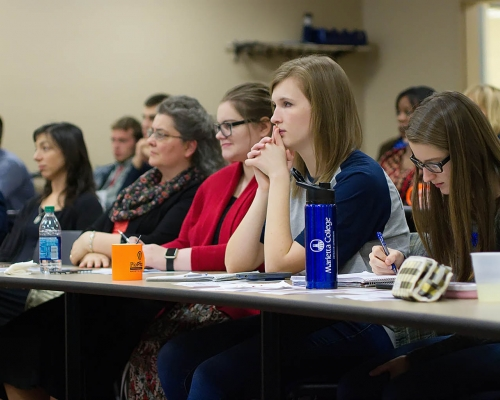 Marietta College students watch a PioPitch presentation