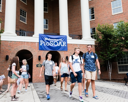 New Students walking out of a PioSOAR session in Harrison Hall