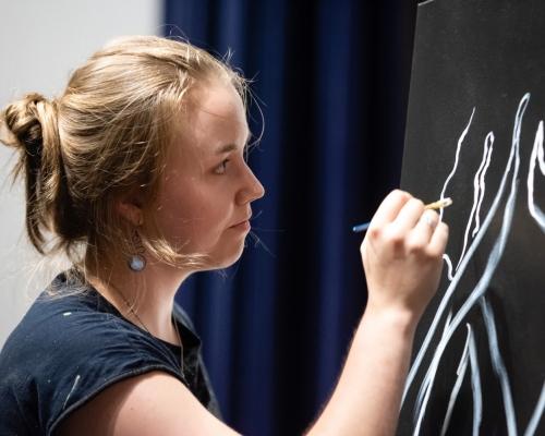 Female student working on chalk art