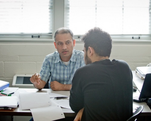 Professor helping a student in his office