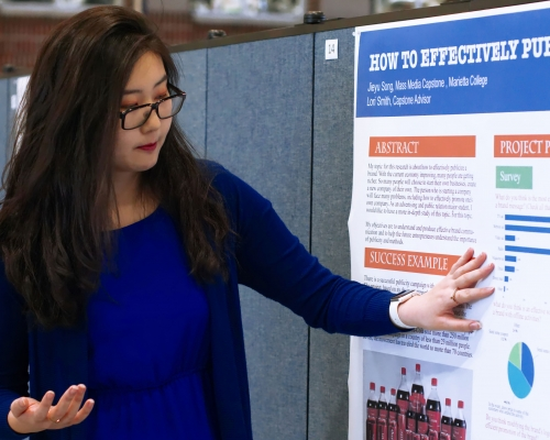 Student presenting at All Scholars Day
