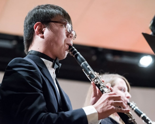 Student performing in band concert