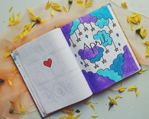 Doodle in a journal with the word April