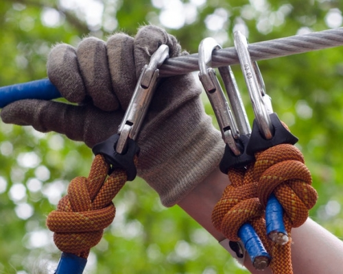 Hand in a glove hanging on a zipline