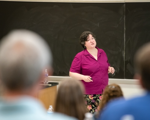 Faculty member Lynn Bostrom speaking to a crowd