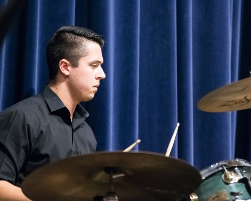 College student playing drums