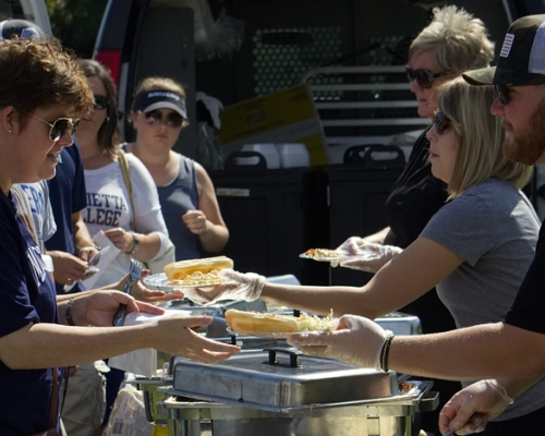 Families eating at the football tailgate