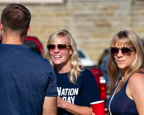 Two women wearing navy blue tops at Don Drumm Stadium