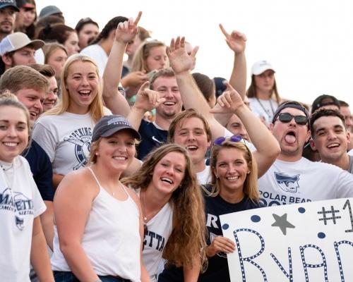 Marietta students cheering on the football team