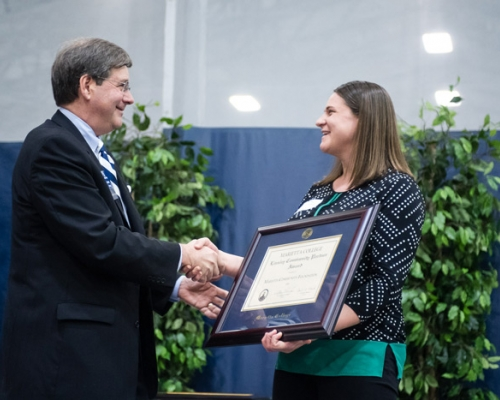 President Ruud presenting Heather Allender with an award