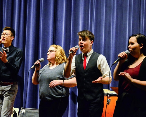 four students singing