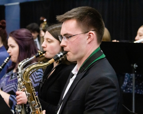 Male student playing the saxophone