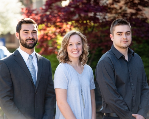Three students who were inducted into Phi Beta Kappa in 2018