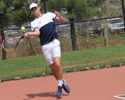 Men's tennis player returning a shot