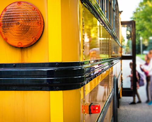 Children getting on a school bus