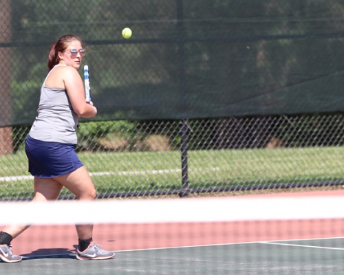 Marietta College women's tennis player returning a shot