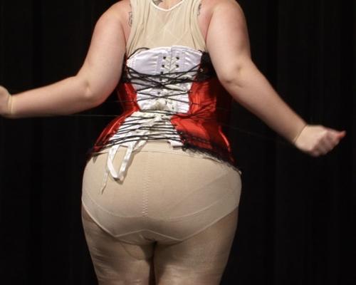 Woman facing away in a corset