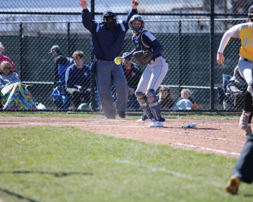 Softball catcher looking to throw to third base
