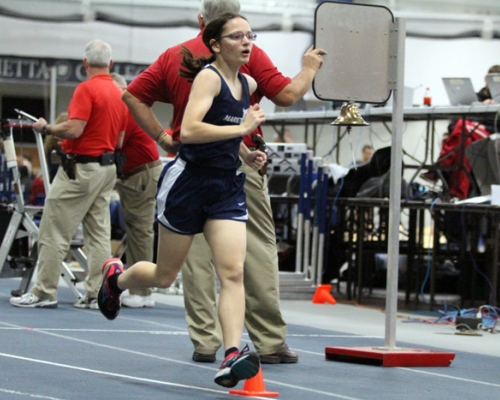Female track athlete running in the DBRC