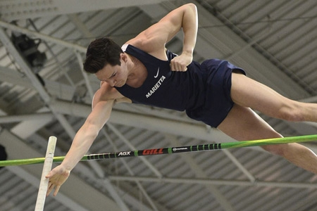 Jim Kovatch clearing the bar during a pole vault